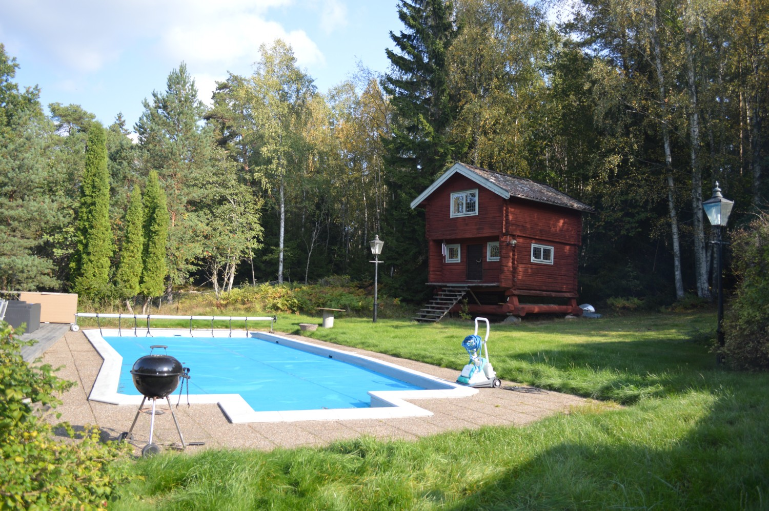 Poolen och härbret/ Swimming pool and old grain house